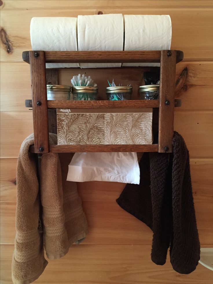 Old sewing machine drawer repurposed into bathroom shelf