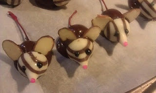 So Cute!!! Hershey Hugs and Chocolate covered Cherry Mice :)       Maraschino Cherries WITH the stems      almond slices      Hersheys kisses      Bag of chocolate chips      Pink cookie frosting in a tube      Black cookie frosting in a tube      wax paper      cookie sheet