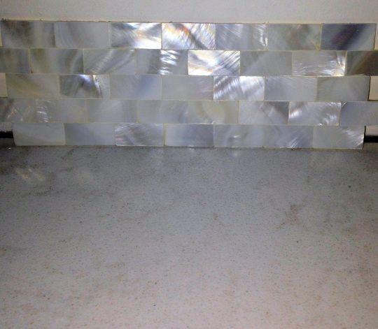 mother of pearl backsplash tile groutless tile master bathroom