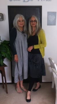 Sisters celebrating long gray hair. Wish I had a sister to celebrate (anything) with! Meanwhile, I really like the sister-on-the-left's gray jumper/pinny.