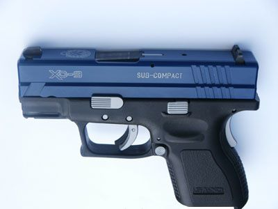 Springfield XD 9 subcompact... great for small hands.-bro!and it's navy and grey!! YES!!!