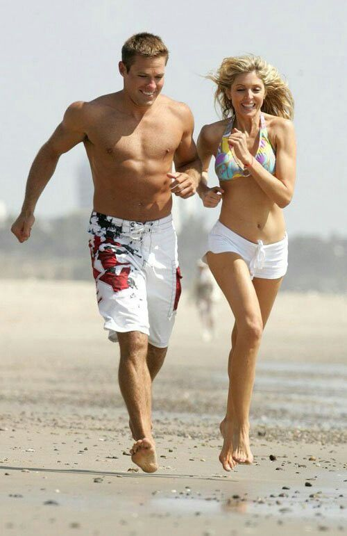 Marla Maples running on the Beach with her boytoy.
