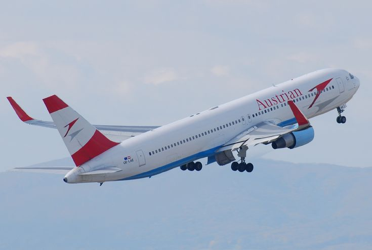 Rear quarter view of an Austrian Airlines 767 takeoff, with red winglets.