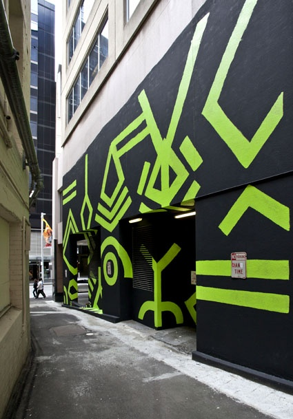 """""""Simple, bold and beautiful, just like Sydney in summer…""""  Brett Chan's future-primitive mural in Carruthers Place pops and shimmers and responds to the architecture and surrounds, completely transforming the lane."""