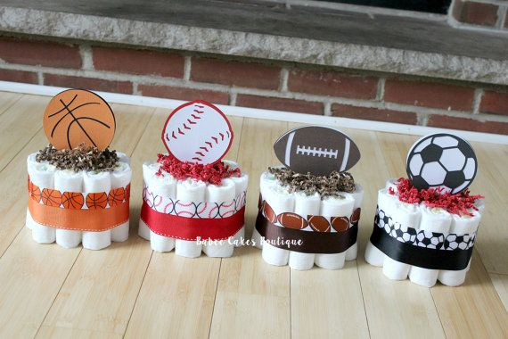 These adorable mini cakes are perfect for displaying on a mantle, table décor or simply scattered around your shower. Each cake measures approx. 8 tall and 6 wide - and comes with 10 size 1 Pamper Swaddlers. Available in a variety of sizes. Colors can be changed to match your theme. Toppers are double sided! Need this in a different quantity? Message me for a custom listing, additional mini cakes are $10 each. >>> Other Sizes Options <<< --Lg single tier (20 diapers) --2 tie...