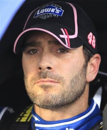 Jimmie Johnson sits in his car as he looks at results during qualifying for Sunday's NASCAR Sprint Cup Series auto race at Martinsville Speedway in Martinsville, Va., Friday, Oct. 26, 2012 where he won the pole.