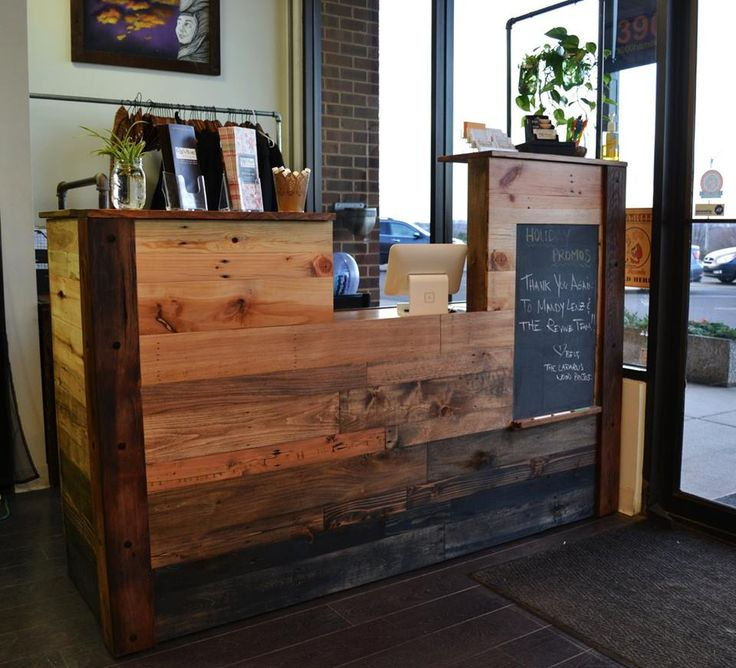 Reception desk with various earth elements. Reclaimed pallet wood, barn wood, slate, metal, and living plants.