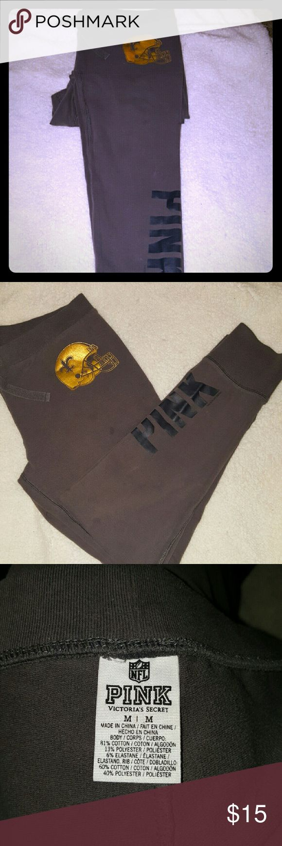*TODAY ONLY SALE* Victoria's secret PINK SPECIAL These are a NFL limited edition pink legging sweatpant they have been used and only flaw is the two small oil or grease spots in picture its on the right leg only the one side has the football saints helmet and pink on the bottom in black letters up the leg other side is plain size M good for game day at home PINK Victoria's Secret Pants Leggings