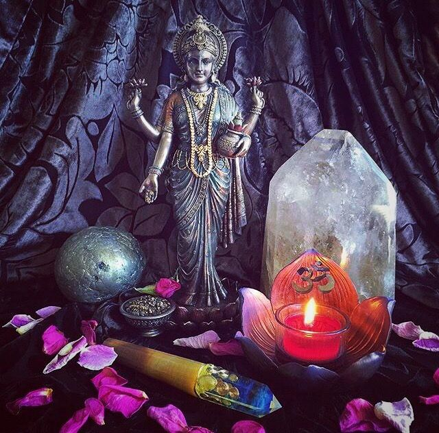 Lakshmi. Wait until you see her. Wait until you feel her commanding energy. This gorgeous Hindu goddess of wealth and prosperity is not just the centerpiece for your altar – she is the centerpiece for your entire ceremony room.  I placed her at the center of my altar and could not take my eyes off of