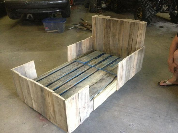 The Toddler Bed that I made last year for my niece out of pallets. I probably spent a total of $35 on screws and wheels to make this thing. It is solid and still looking great!