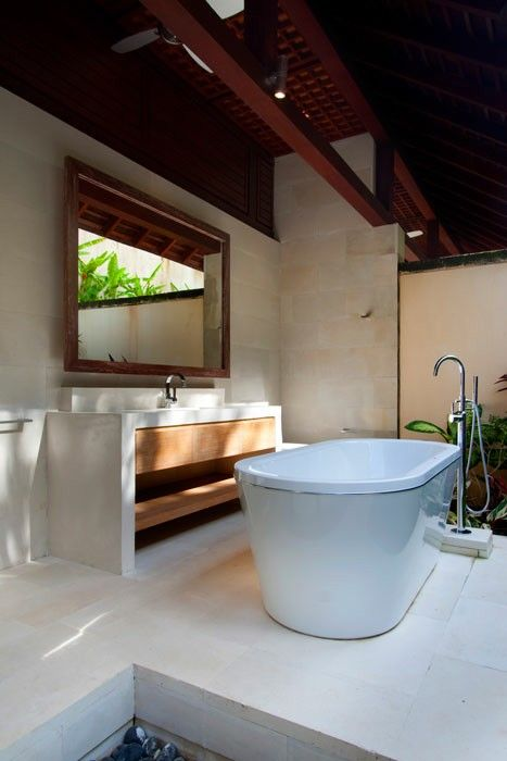 Semi outdoor bath tub...feel very close to the balinese landscape and blended with the nature.