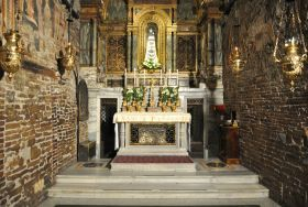 An ancient tradition recounts that the Holy House of Loreto il the same walled Chamber of Our Lady that had existed in Nazareth, in Galilea, in which Mary was born, was brought up and received the angelic annunciation.