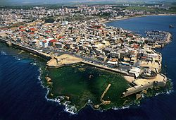 Acre (/ˈɑːkər/ or /ˈeɪkər/, Hebrew: עַכּוֹ, ʻAkko, most commonly spelled as Akko; Arabic: عكّا, ʻAkkā) is a city in the northern coastal plain region of northern Israel at the northern extremity of Haifa Bay. The city occupies an important location, as it sits on the coast of the Mediterranean, traditionally linking the waterways and commercial activity with the Levant. Acre is one of the oldest sites in the world.