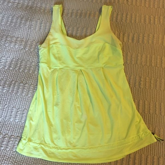 Lululemon tank Lululemon tank top.  Citrus yellow with mesh accents. Gentle use. Size 6 lululemon athletica Tops Tank Tops