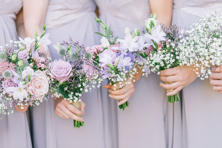 Lilac roses and gipsophila bridesmaid posies -  Image by Georgina Harrison - Rustic Marquee Wedding In Yorkshire With A Lavender And Dove Grey Colour Scheme With Bride In Cymbeline Of Paris Dress