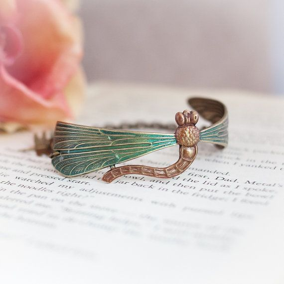 This Outlander inspired bracelet features a hand painted dragonfly stamping, accented with an amber charm and czech green flower bead.