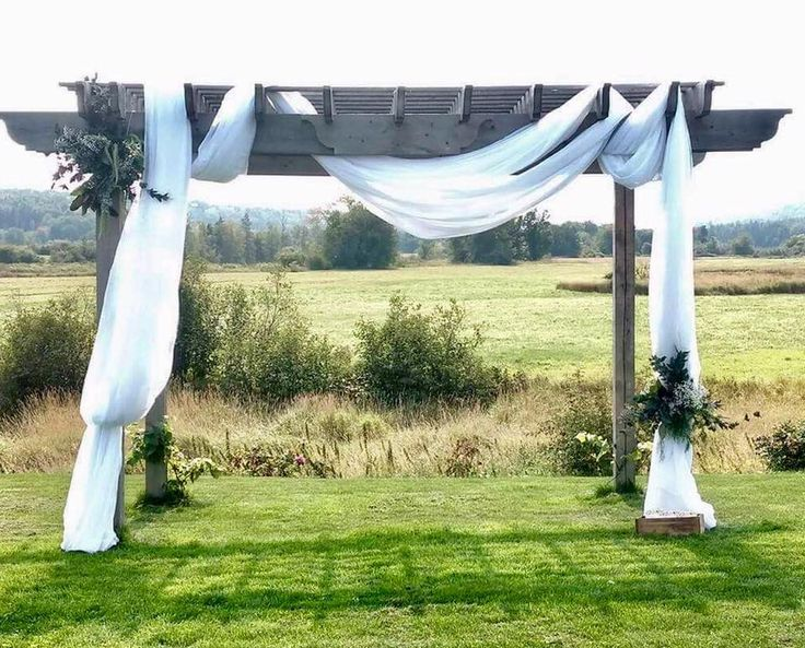 #cldesigns #cldesignteam #ceremonyspaces #outdoorwedding #outdoorceremony #asymmetrical #archway #greenery #whitedrapes #barnwedding #newbrunswickwedding