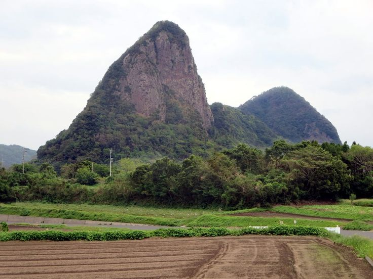 The sugarloaf cone of Mount Takeyama near Yamagawa at the southern end of Kyushu Island, Japan, is visible from afar.