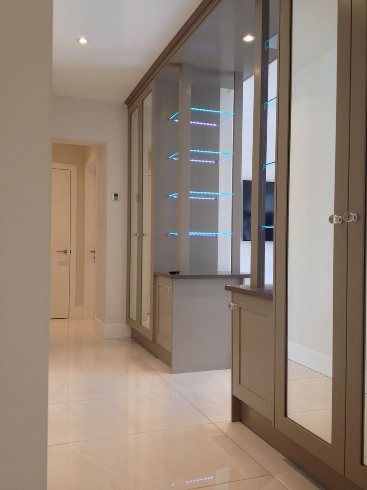 Added shelving in a hall archway with subtle shelf lighting.    Bespoke Design by Anthony Mullan furniture. Find out more at www.anthonymullan.com