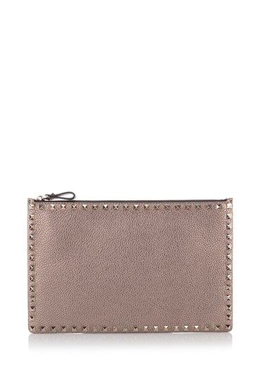 Pouch by #Valentino Garavani in metallic taupe leather with polished metal studs, top zip and cotton lining. http://bit.ly/1Pxl0X0