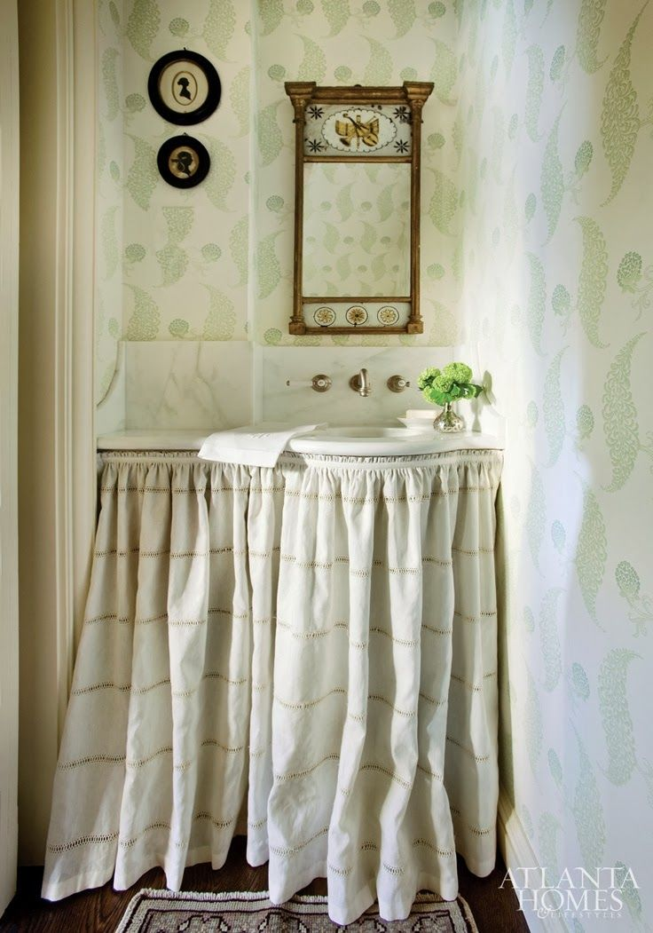 Things We Love:  Skirted Sinks Really like the wallpaper, the mirror and the small curved sink.  Looks so perfectly customized for the space.