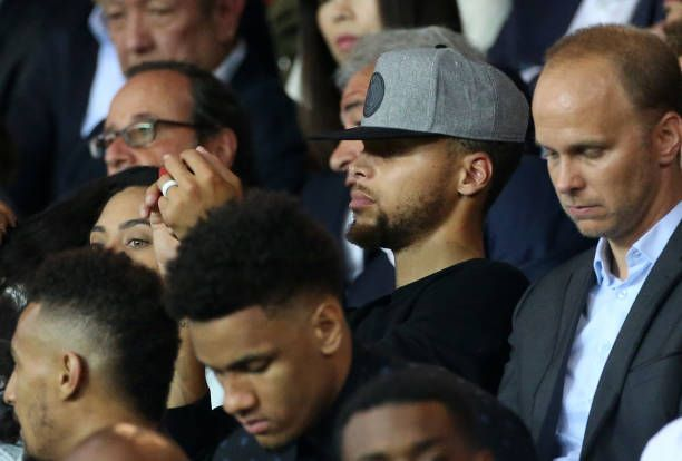NBA champion Stephen Curry of Golden State Warriors attends the French Ligue 1 match between Paris Saint Germain and AS SaintEtienne at Parc des...