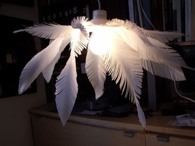 """""""Feather"""" lamp.  I thought it was real feathers and wondered where they got the huge feathers.  It's milk jug plastic!  hehe"""