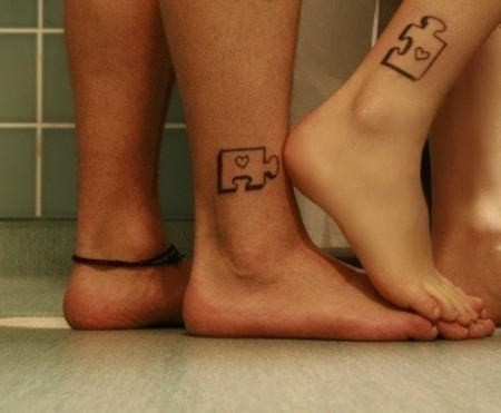 Matching jigsaw tattoos, cute.