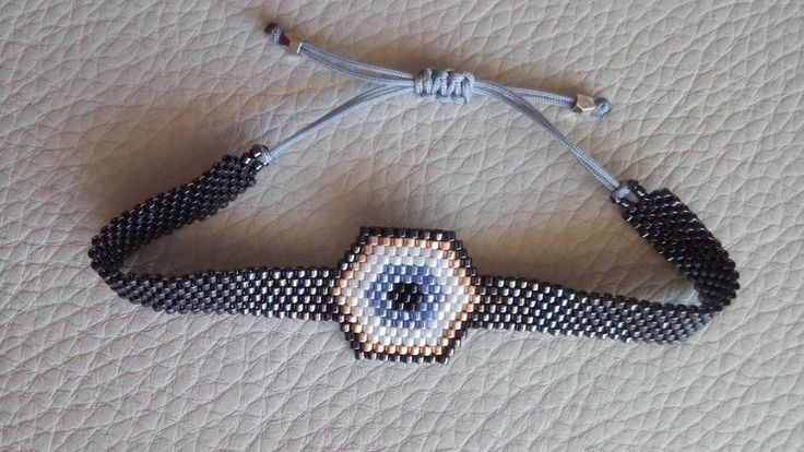 Evil Eye - Handmade beaded bracelet with Miyuki delica seed beads by SouSouHandmadeArt on Etsy https://www.etsy.com/listing/475578892/evil-eye-handmade-beaded-bracelet-with