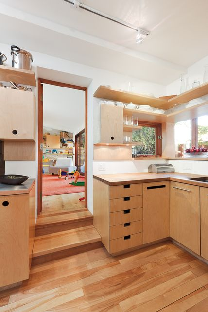 A nice simple kitchen - I think the two timbers of the floor and cabinets clash a little too much and the drawer pulls are not quite the right proportions but is still a great reference for cut-out drawer pulls.