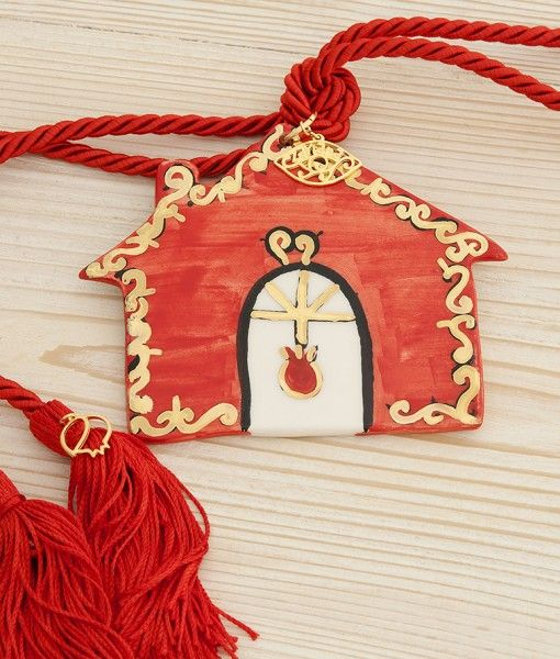 Beautiful hand-painted ceramic lucky-charm with gold details. It can be used as a door or wall hanging. The perfect gift for a new home or any other occasion.