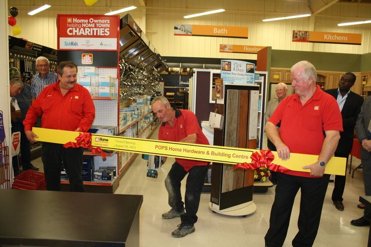 The official cutting of the board signifying the opening of Pops Home Hardware and Building Center.