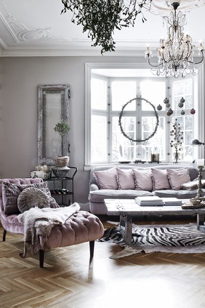 Lavender and grey living room with bay window, tufted chaise lounge, chevron parquet wood floors, crystal chandelier.....x: