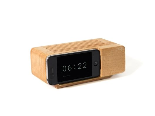 Place an iPhone or iPod Touch on the Front of this Dock.....time, music and charging at your finger tips.