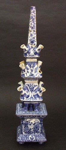 A Rare Kangxi Blue and White Porcelain 'Flower Pyramid' in the Delft Pottery Style of Adriaen Kocks (De Griexe A Factory). Large flower pyramids of this type were made in Holland for William and Mary at Hampton Court among other palaces. Compare to the flower pyramid at Hampton Court and illustrated in : 'Delffs Porcelijn' Van Koningin Mary II, Queen Mary's 'Delft Porcelain', Ceramics at Het Loo from the Time of William and Mary. Page 41 illustrated on page 40 ; dated to 1689-1695.