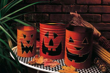 Save those cans! You can whip up some quick Jack-O-Lantern Luminaries with just a couple supplies. #handmade #craft #Halloween