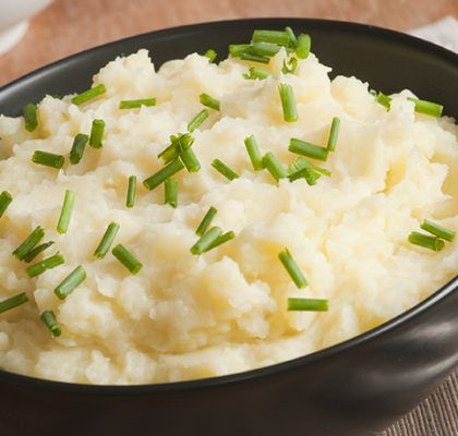 Smoked mashed potatoes with chives in a bowl