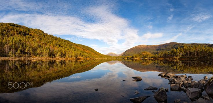 Tranquility at the Lake - A dead calm lake reflecting the trees and mountains surrounding it. A beautiful autumn day in Norway.