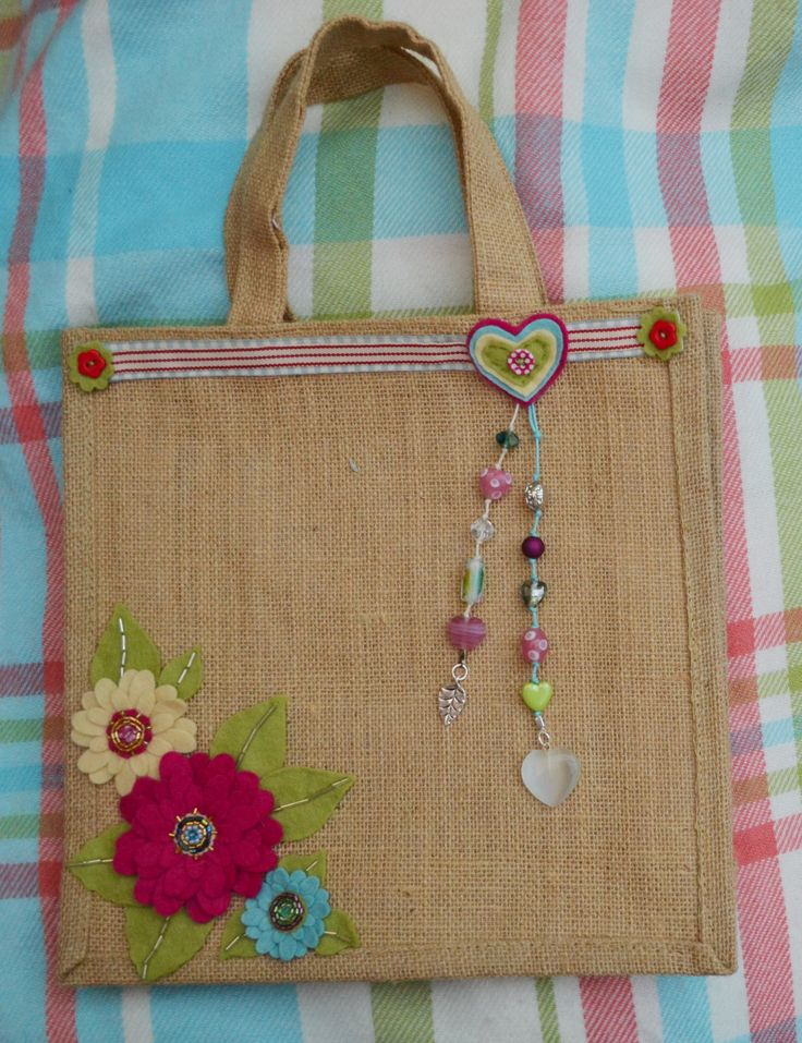 Jute bag flower design by Claire McKay.