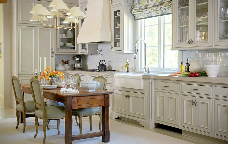 bump out cabinet to accommodate a fireclay sink with an industrial faucet - interesting combination