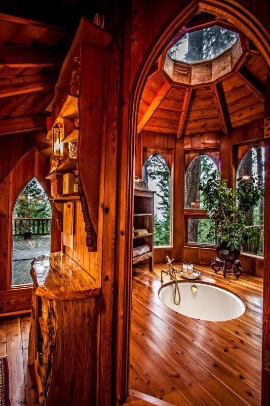 """This is the """"Hobbit Treehouse."""" Located on Orcas Island in Washington State. The three circular pods are all connected by hallways, decks, and bridges – evoking a certain charm reminiscent of the Ewok Village in Star Wars or an elven treehouse. The treehouse is now for rent for guests and visitors."""