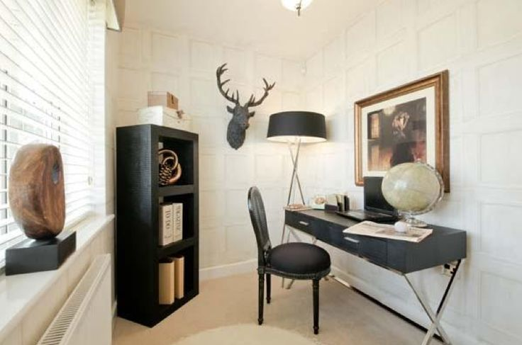 Masculine interior designed study area with stag head and modern leather desk - using a faux white panelled wallpaper. Young & Battaglia do a lovely version of this. Adore the vignette.