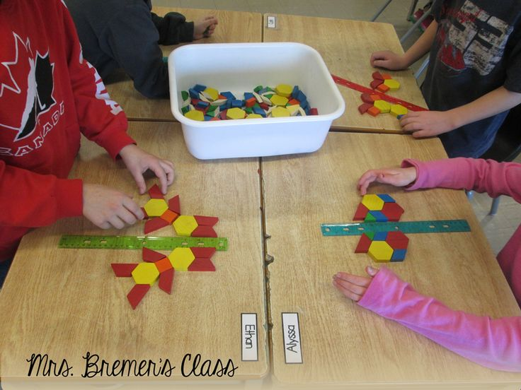 Symmetry Activity: Students use a ruler to create a 'line of symmetry', then use blocks or other materials to get create a symmetrical design.