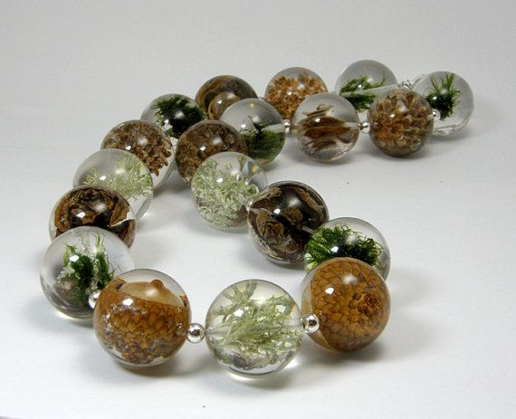 Amazing resin jewelry by Polish designer, Sylwia Calus... truly one of a kind designs!