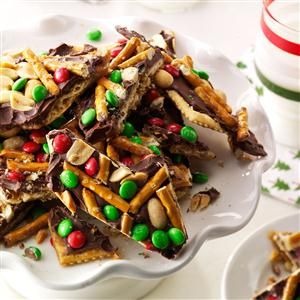 """Chocolate, Peanut & Pretzel Toffee Crisps Recipe -Crispers are the ultimate combination of salty and sweet. These treats never last long because they are addictive—you can't eat just one! Though these are the """"favorite"""" toppings, crispers can be topped with any number of items. —Jennifer Butka, Livonia, Michigan"""