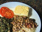 Here's a traditional Southern-style meal designed to bring you good luck in the New Year. This New Year's Day dinner features delicious skillet cornbread, easy seasoned mustard greens, spicy black-eyed peas, hot cooked rice, and a wonderful peach upside-down cake.