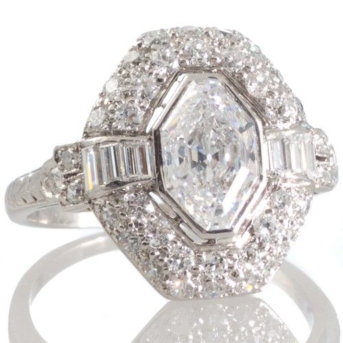 An original French Art Deco diamond engagement ring, with a central modified baroness cut diamond. View our collection of antique, Art Deco, and modern jewellery at www.rutherford.com.au