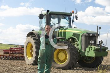 Royalty Free Photo of a Farmer With a Tractor