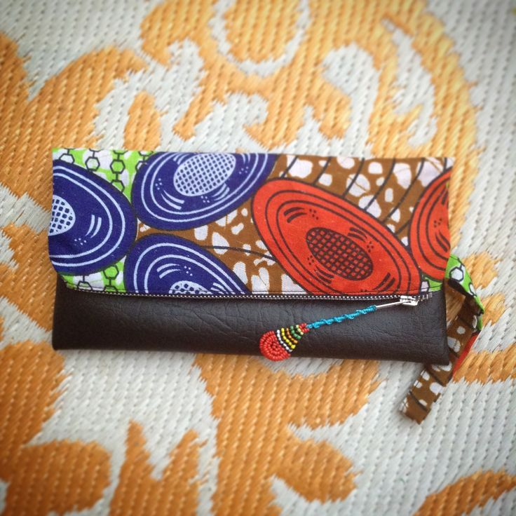 Fold Over Clutch Bag - 'Mama Africa' African Wax Print with Black Faux Leather Trim - Bridesmaid's Gift - (MABL2) by ChangNoii on Etsy
