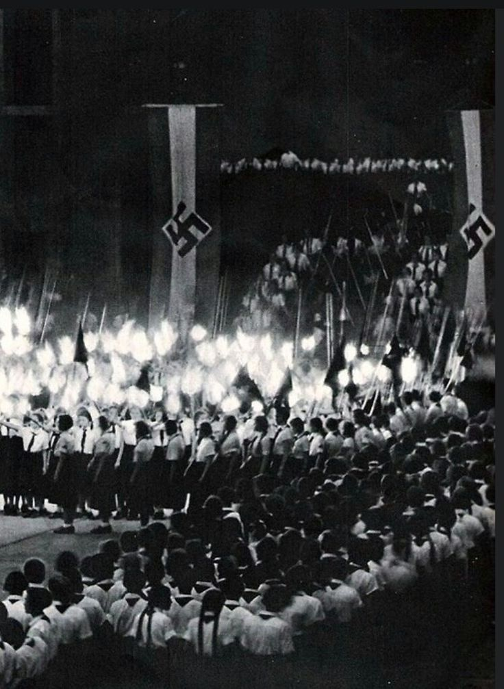 """hundreds of Bund Deutscher Mädel (""""Band of German Maidens"""") members gathered at a large rally. The Bund Deutscher Mädel is essentially the female version of the Hitler Youth. Members partake in activities which the NSDAP deemed crucial for the shaping of the ideal German woman."""